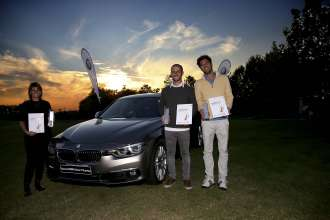 BMW Golf Cup International 2015. The three winners of the 2015 edition which took place at the Golf Club Arzaga: Daniel Raccagni, Marco Sanna and Mara Fanti next to the BMW 7-Series (10/2015).