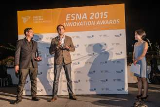 Dr. Simon Ellgas Senior Advanced Technology Engineer - Sustainable Mobility, BMW Group Technology Office USA accepts ESNA Innovation Award for BMW i ChargeForward battery 2nd life storage solution