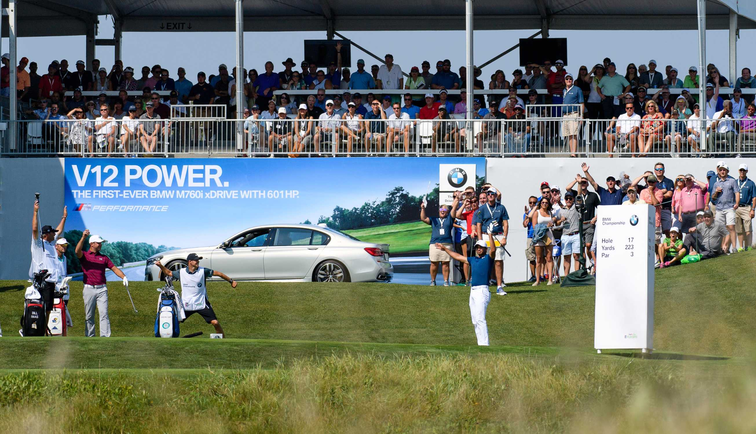 perfect day! australian jason day hits an ace to win a bmw m760i
