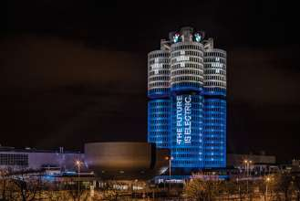 "The BMW Group has delivered more than 100,000 electrified vehicles to customers worldwide in 2017, as promised at the beginning of the year. An eye-catching light installation transformed the BMW Group headquarters, the world-famous ""Four-Cylinder"" in the north of Munich, on the evening of 18 December 2017 into a battery. (Ralph Larmann, 12/2017)"