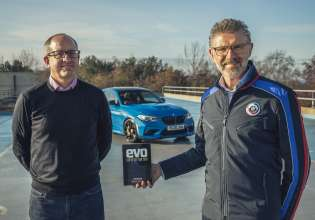 Stuart Gallagher (L), Editor, Evo, and Graeme Grieve (R), Chief Executive Officer, BMW Group UK.