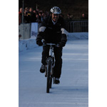 Seefeld, Austria, 6th December 2003. Dr. Mario Theissen (BMW Motorsport Director) rides a bicycle on ice (01/2004)