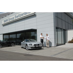 The lucky winner, Gregor Hoffmann, accepts his prize. A brand new BMW Z4 Roadster 2.0i