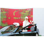 Brady White as Santa Claus helps unveil the Neiman Marcus Limited-Edition 2009 BMW Individual 7 Series during the unveiling of the the 82nd edition of the Neiman Marcus Christmas Book in Irving, Texas, Tuesday, October 7, 2008. The car is featured in the Christmas Book (10/2008)