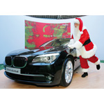 Brady White as Santa Claus shines the Neiman Marcus Limited-Edition 2009 BMW Individual 7 Series during the unveiling of the the 82nd edition of the Neiman Marcus Christmas Book in Irving, Texas, Tuesday, October 7, 2008. The car is featured in the Christmas Book (10/2008)