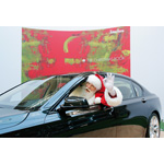 Brady White as Santa Claus waves from the Neiman Marcus Limited-Edition 2009 BMW Individual 7 Series during the unveiling of the the 82nd edition of the Neiman Marcus Christmas Book in Irving, Texas, Tuesday, October 7, 2008. The car is featured in the Christmas Book (10/2008)