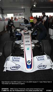 NIgel Mansell in the BMW Sauber F1.07 in the BMW Sauber F1 Team Pitlane Park At The British GP Silverstone England.