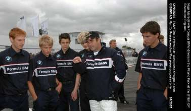 Nigel Mansell with Formula BMW drivers in the Pitlane Park at the British GP Silverstone England.