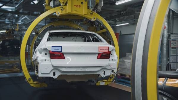 Artificial intelligence to control whether correct model designations are attached, BMW Group Dingolfing Plant.